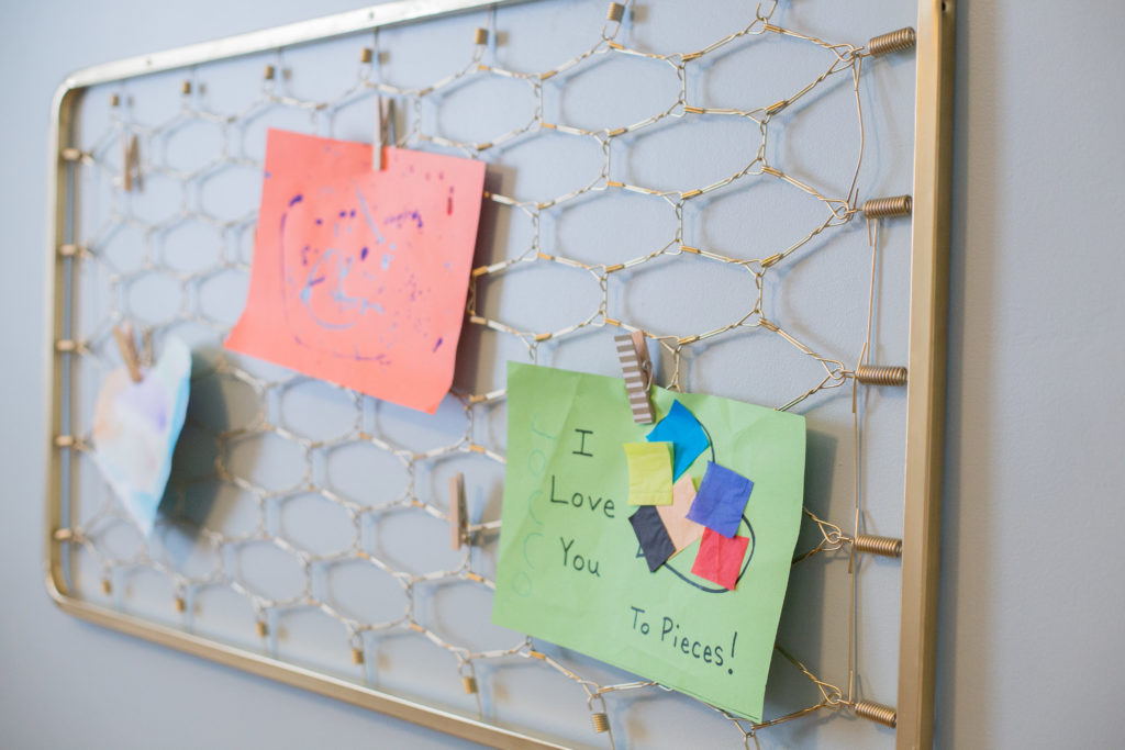 Turn your child's old crib springs into artwork storage with this DIY tutorial.