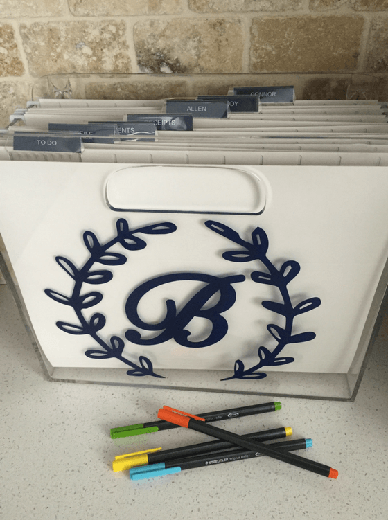 What do you do with your mail, kid's artwork, school papers? Create an action file to organize the clutter. These file bins are great storage.